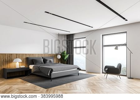 Corner Of Modern Bedroom With White And Wooden Walls, Wooden Floor, Comfortable King Size Bed And Ar