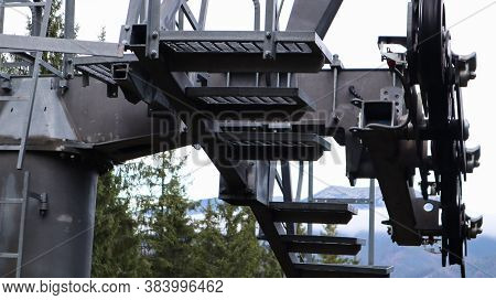 A Close-up Of The Chairlift Mechanism. The Industrial Concept Of The Sky Cable Terminal Section. Con