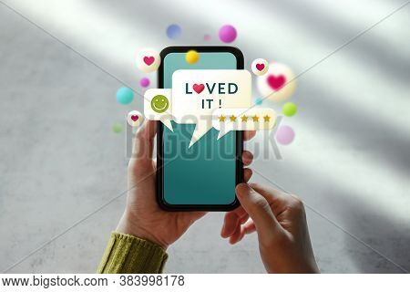 Customer Experiences Concept. Woman Using Mobile Phone To Giving Feedback Via The Internet. Positive