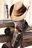 gun and hat under sunlight, western spirit poster