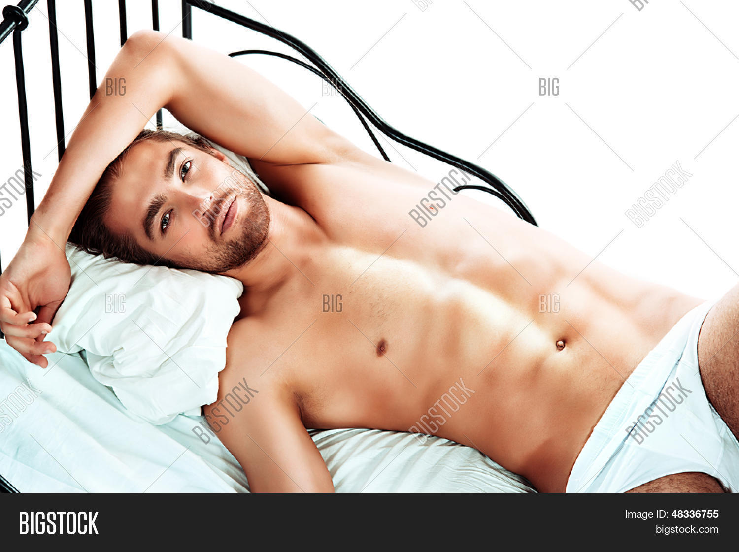 Man lying nude in bed strip