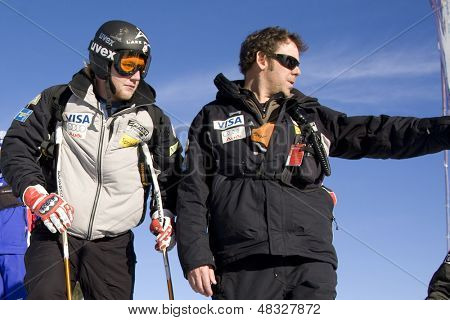 KITZBUHEL TIROL, AUSTRIA - JAN 24 2009; Kitzbuhel Tirol Austria, Andrew Weibrecht (USA) gets advice from coach Chris Brigham for the Hahnenkamm race  the men's downhill ski race part of the Audi FIS Alpine Ski  World cup.