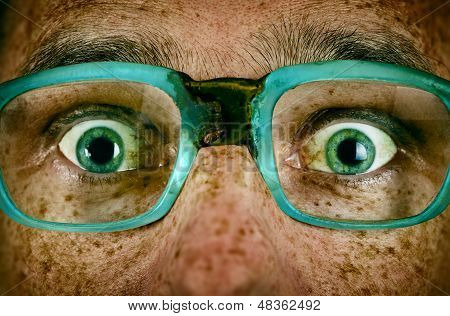 Frightened Look Of A Man In Old Glasses