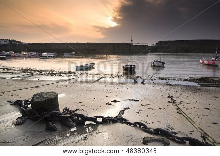 A traditional Cornish fishing village at sunrise in Cornwall England