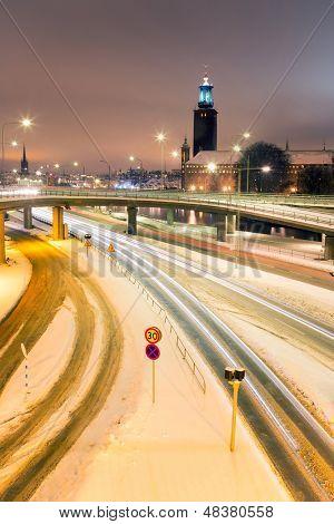 Stockholm Cityhall at night with transportation light trail Sweden