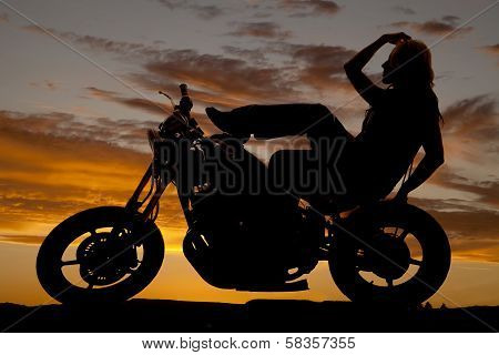 Silhouette Of Woman On Motorcycle Hand Hair Leg Up