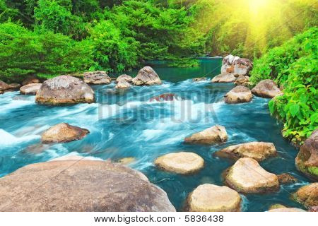 Blue water stream. Phong Nha - Ke Bang National Park. Vietnam poster