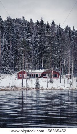 Wooden cottage by the river in Central Finland