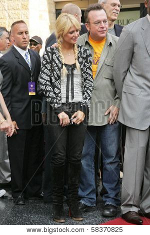 Paris Hilton and Tom Arnold at the Ceremony Honoring Los Angeles Lakers Owner Jerry Buss with the 2,323rd star on the Hollywood Walk of Fame. Hollywood Boulevard, Hollywood, CA. 10-30-06