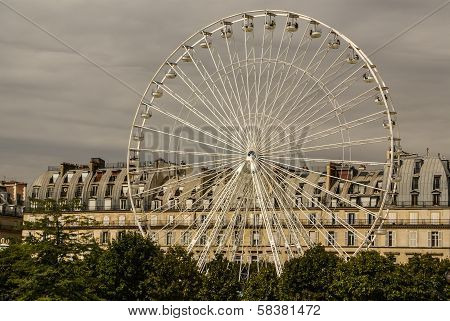 Ferris Wheel (roue De Paris) On The Place De La Concorde From Tuileries Garden. Ferris Wheel Was Ins