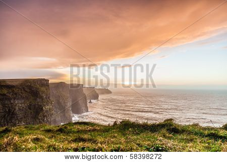Famous cliffs of Moher at sunset in Co. Clare Ireland Europe. Beautiful landscape natural attraction. poster