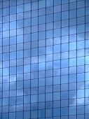 Vertical image of sky reflection on glass wall building poster