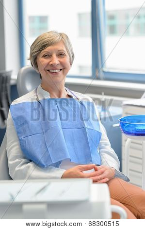 Elderly woman patient sitting chair at dental surgery teeth checkup