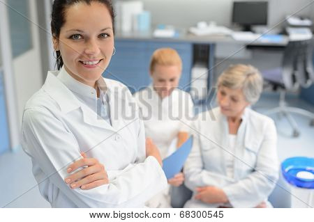 Professional dentist woman looking camera senior patient dental  assistant surgery