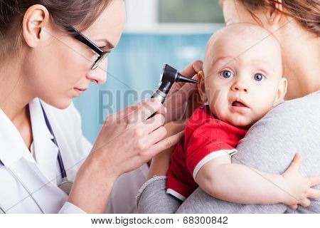 Doctor Examining Baby Boy With Otoscope