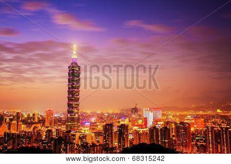 Taipei's City Skyline At Sunset With The Famous Taipei 101