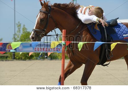 LYTKARINO, MOSCOW REGION, RUSSIA - JULY 12, 2014: Svetlana Markina performs stunts during Russian championship in trick riding. Lytkarino housed the Russian Federation of trick riding
