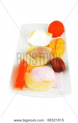 melt ice cream and fruits on plate