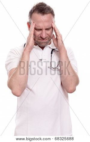 Male Doctor Suffering From A Headache