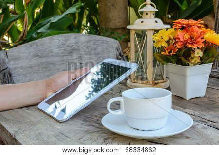 Coffee, Tablet On Wood Floor With Flower