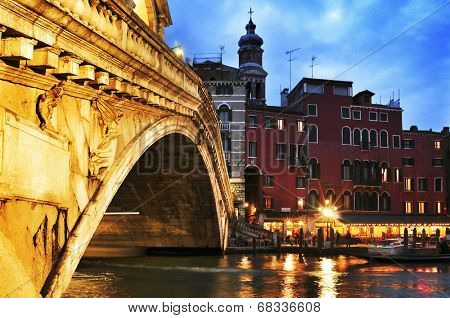 VENICE, ITALY - APRIL 11: View of Rialto Bridge and Grand Canal at sunset on April 11, 2013 in Venice, Italy. This main canal is 3800 meter long, 30-90 meters wide, with an average depth of 5 meters