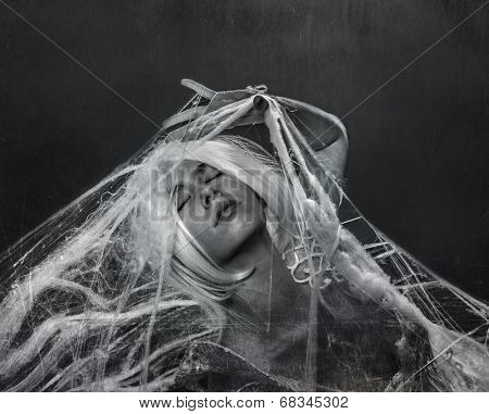 beautiful white-haired woman caught in a spider web