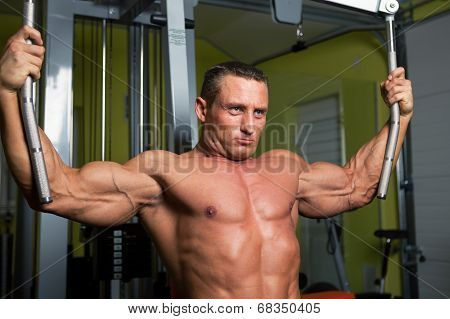 Muscle Shaped Man Exercise On Sport Gym Fitness Club