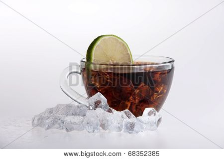Iced tea with lemon and mint isolated on white background