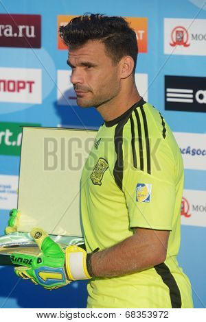 MOSCOW, RUSSIA - JULY 13, 2014: Goalkeeper of team Spain F. J. Donaire aka Dona on the award ceremony during Moscow stage of Euro Beach Soccer League. Dona became the best goalkeeper of the stage