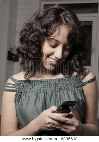 Young female reading a text message