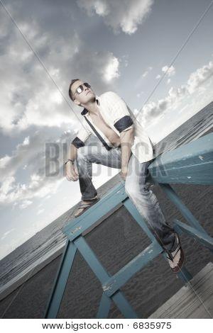 Man on a lifeguard hut