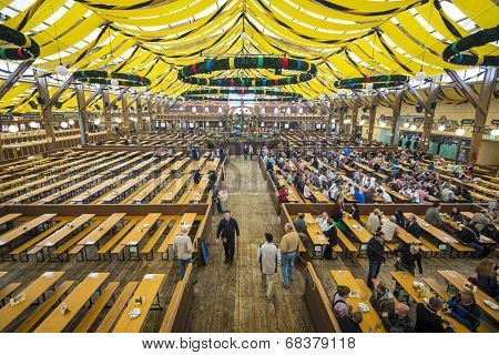 MUNICH, GERMANY - SEPTEMBER 30, 2013: The Paulner Beer Tent on the Theresienwiese Oktoberfest fair grounds. The 16 day festival has been annually celebrating beer since 1810.