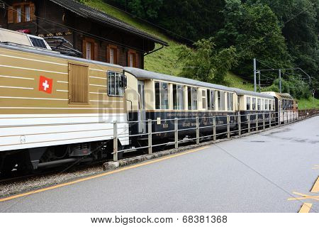BROC, SWITZERLAND - JULY 8, 2014: The Chocolate Train at station. The vintage luxury tourist train departs from Montreux to stops in Gruyere and Broc for cheese and chocolate factory tours.