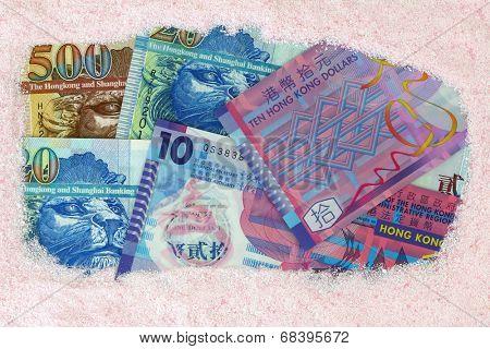 Money laundry : Hong kong dollar banknotes under pink Laundry washing powder