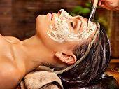 Woman having facial mask at ayurveda spa. poster