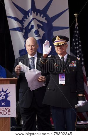 NEW YORK - NOV 11, 2014: (Ret) Lt Col Dwight Webster waves to parade marchers from the VIP stage during the 2014 America's Parade held on Veterans Day in New York City on November 11, 2014.