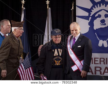 Grand Marshall Raymond Kelly, former NYC Police Commissioner and USMC Vietnam War veteran, stands next to a Navy vet during the 2014 America's Parade in New York City on Veterans Day, 2014.
