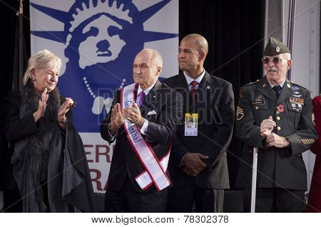NEW YORK - NOV 11, 2014: Grand Marshall Raymond Kelly, former NYC Police Commissioner and USMC Vietnam War veteran, applauds parade marchers during the 2014 America's Parade in NY on Veterans Day.