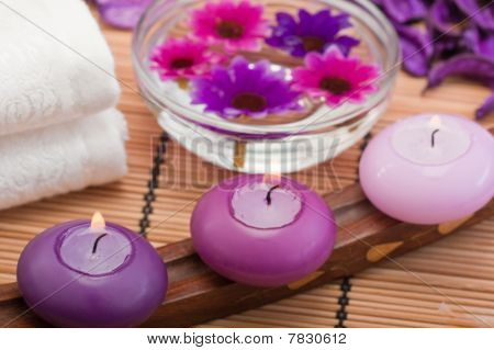 Purple Candles And Flowers In Spa Setting (2)