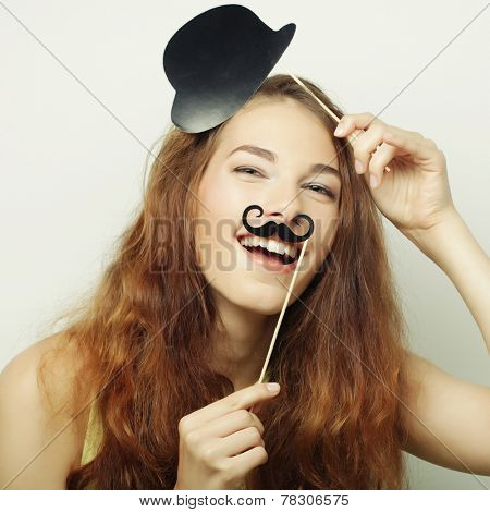 Attractive playful young woman ready for party