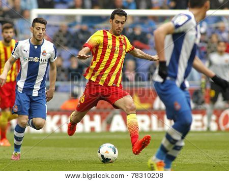 BARCELONA - MARCH, 29: Sergio Busquets of FC Barcelona in action during a Spanish League match against RCD Espanyol at the Estadi Cornella on March 29, 2014 in Barcelona, Spain