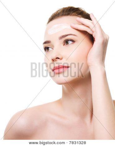 Woman Applying Moisturizer Cosmetic On Forehead