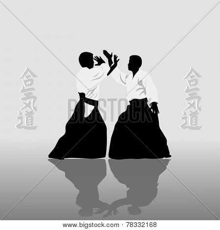 The Two Men Engaged In Aikido On A Light Background..eps