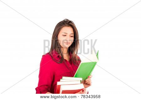 Young Latin Girl Holding Stack Of Books And Reading