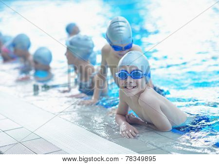 group of happy kids children   at swimming pool class  learning to swim poster