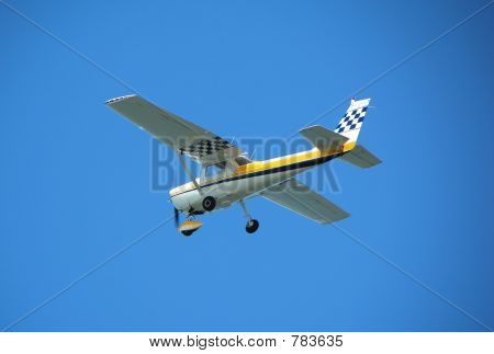 Cessna 150 charter plane in flight poster