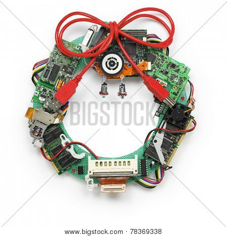 geeky christmas wreath made by old computer parts isolated on white background, no shadow
