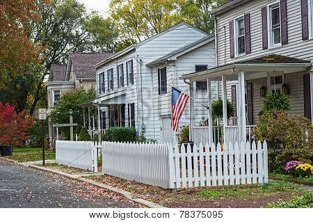 White Picket Fence And Home