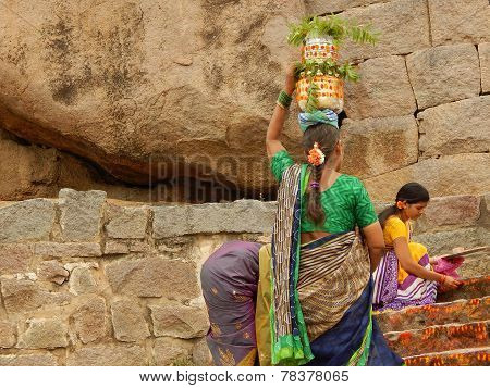 Hindu devotees carry Bonam to the temple in Golconda fort
