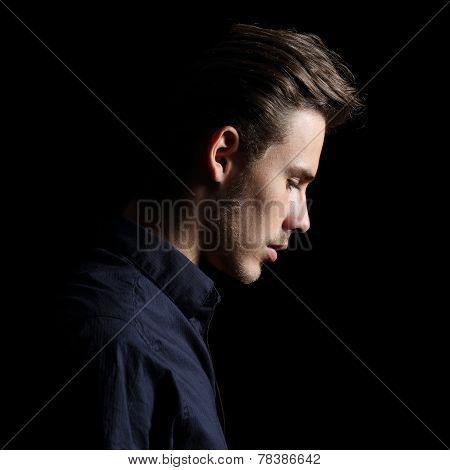 Profile Of A Sad Man Face Crestfallen On Black
